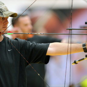 U.S. Army Cpl. Travis Akin lines up a shot while competing in the compound category of the archery competition at the Warrior Games May 12, 2010, at the Olympic training center in Colorado Springs, Colo. Archers from all military branches competed in both recurve and compound bow competitions. (U.S. Air Force photo by J. Rachel Spencer/Released)